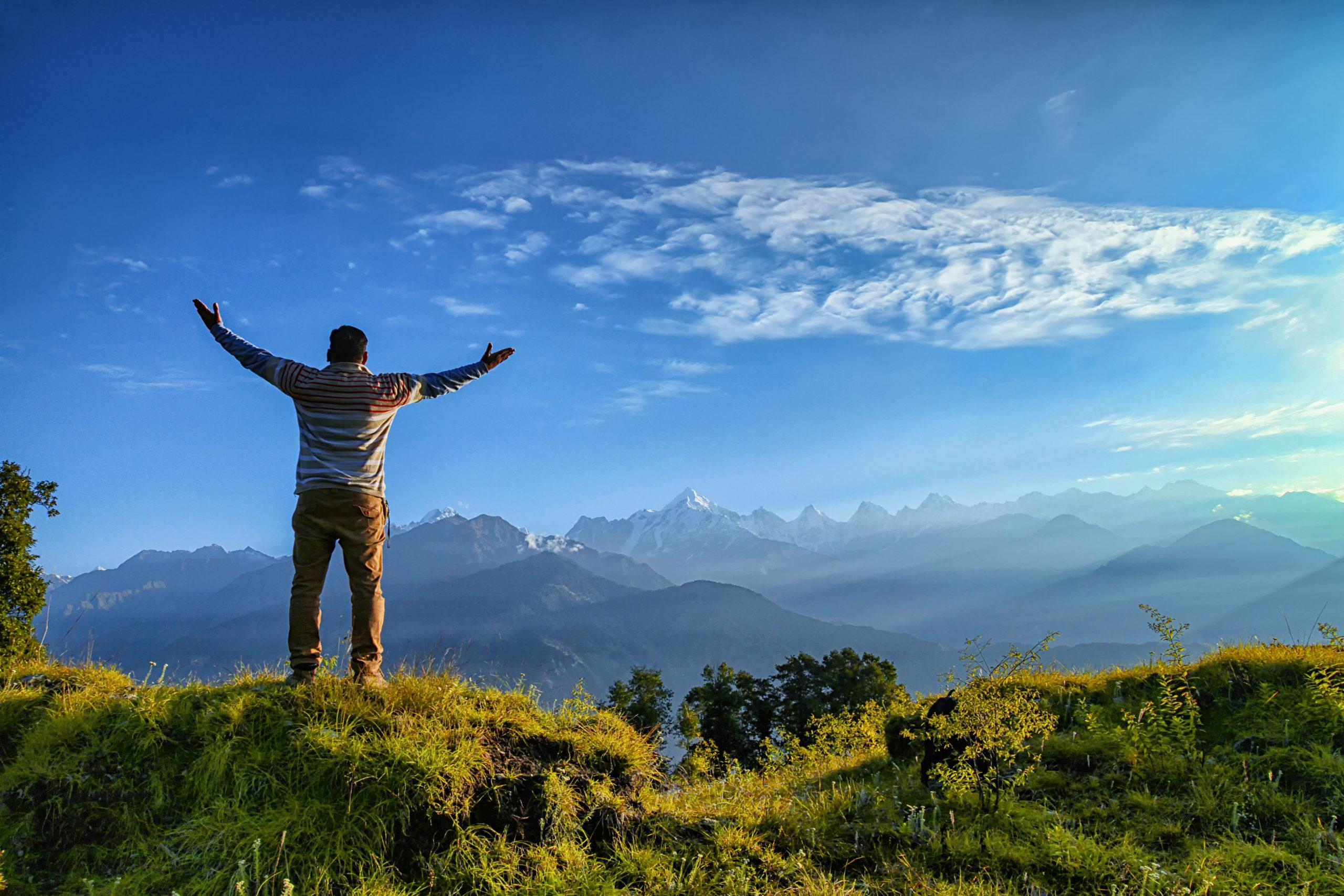 Man standing atop mountain